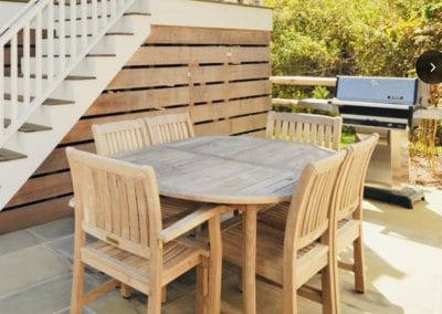 Patio view with table and grill of Nantucket Luxurious Harbor View Cottage Walk to everything23