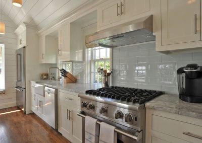 Kitchen marble countertops and high end appliances of Nantucket Luxurious Harbor View Cottage Walk to everything1