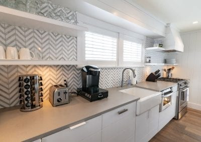 Kitchen with small appliances at antucket MA Rental Cottage, Water View, Beautiful Beach inspired interior