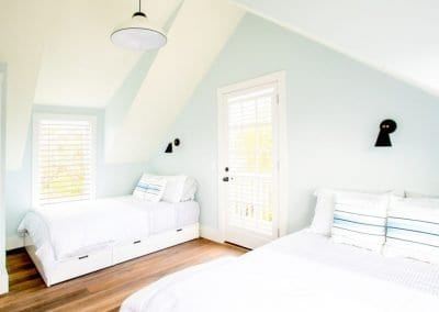 Bedroom with two beds of antucket MA Rental Cottage, Water View, Beautiful Beach inspired interior