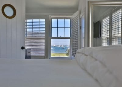view of harber from bedroom of antucket MA Rental Cottage, Water View, Beautiful Beach inspired interior