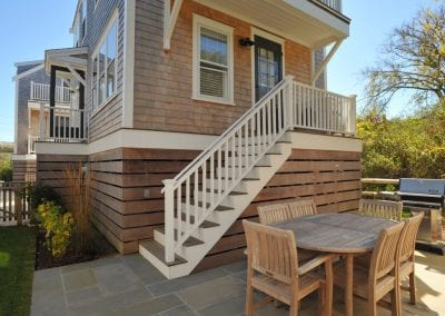 Outside view with dining table Nantucket MA Rental Cottage, Water View, Beautiful Beach inspired interior