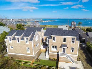Twin cottages arial view with water view from Ackceptional rental property in Nantucket MA